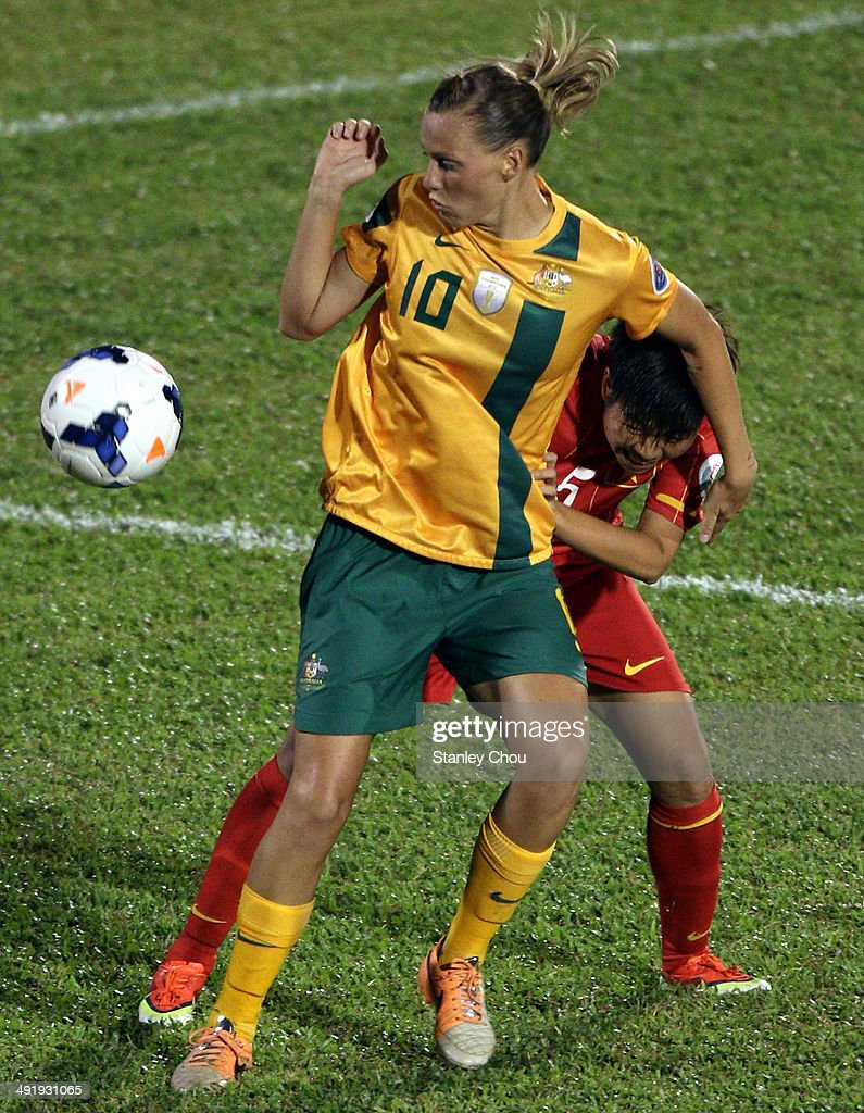 Emily Van Egmond of Australia holds off Bui Thi Nhu of Vietnam during the AFC Women's Asian Cup Group A match between Vietnam and Australia at Thong...