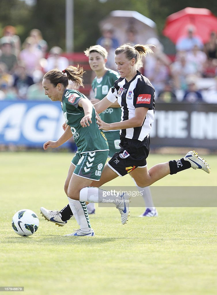 Emily Van Egmond of Newcastle Jets puts pressure on Jennifer Bisset of Canberra United during the round eight W-League match between Canberra United and the Newcastle Jets at Deakin Football Stadium on December 8, 2012 in Canberra, Australia.