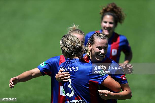 Emily van Egmond of the Jets celebrates a goal with team during the round seven WLeague match between Newcastle and Brisbane at Magic Park on October...