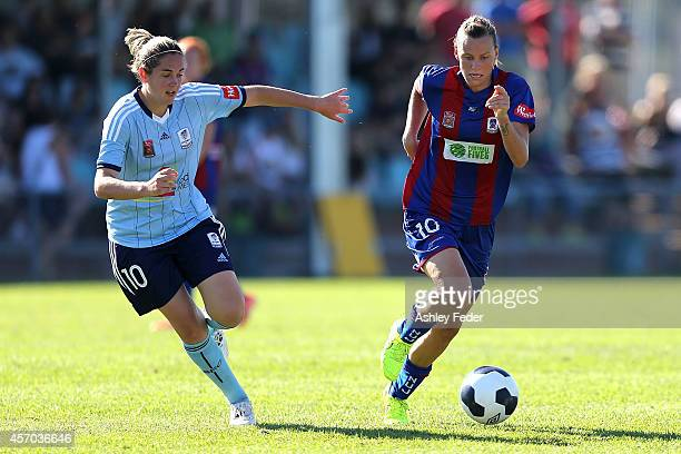 Emily Van Egmond of the Jets controls the ball ahead of Renee Rollason of Sydney FC during the round five WLeague match between the Newcastle Jets...