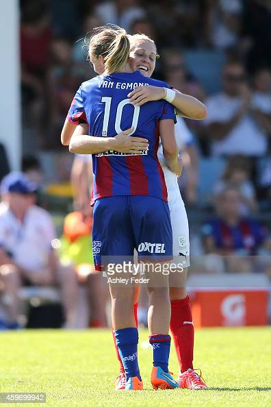 Emily van Egmond of the Jets hugs Danielle Brogan of Adelaide United after the Jets win the round eight WLeague match between Newcastle Jets and...