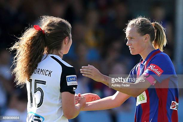 Emily van Egmond of the Jets shakes hands with Jenna McCormick of Adelaide United after the Jets win the round eight WLeague match between Newcastle...