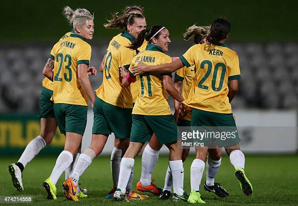 Emily van Egmond of the Matildas celebrates with team mates after scoring a goal during the international women's friendly match between the...