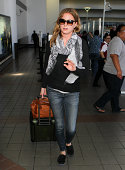 Emily VanCamp is seen at LAX on September 15 2014 in Los Angeles California