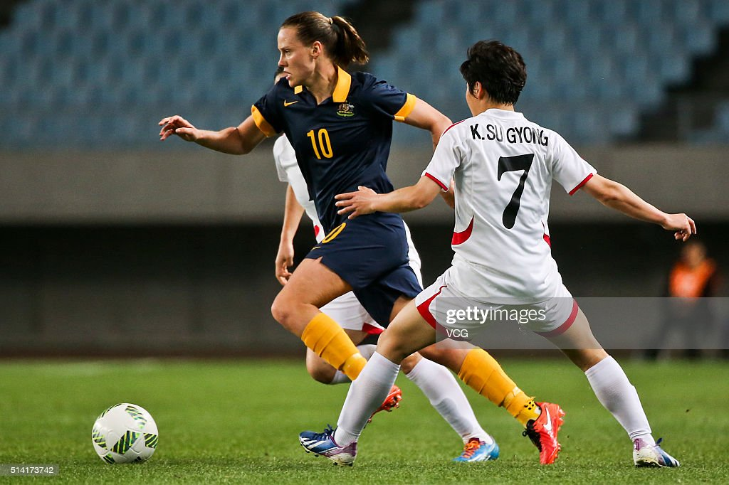 Emily VanEgmond of Australia and Kim Sugyong of North Korea compete for the ball during the AFC Women's Olympic Final Qualification Round match...