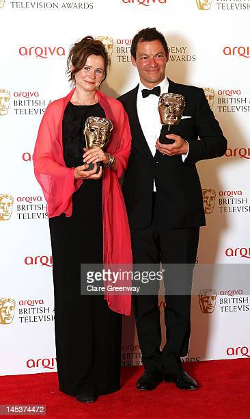 Emily Watson and Dominic West pose in front of the winners boards with the awards for Best Leading Actress and Best Leading Actor at The Arqiva...