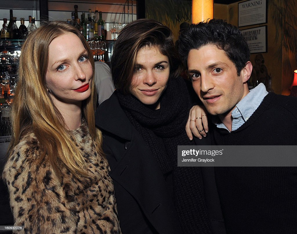 Emily Weiss (C) and Nick Axelrod (R) attend the Band Of Outsiders Fashion Week Mens Collection After Party held at the Monkey Bar on February 7, 2013 in New York City.