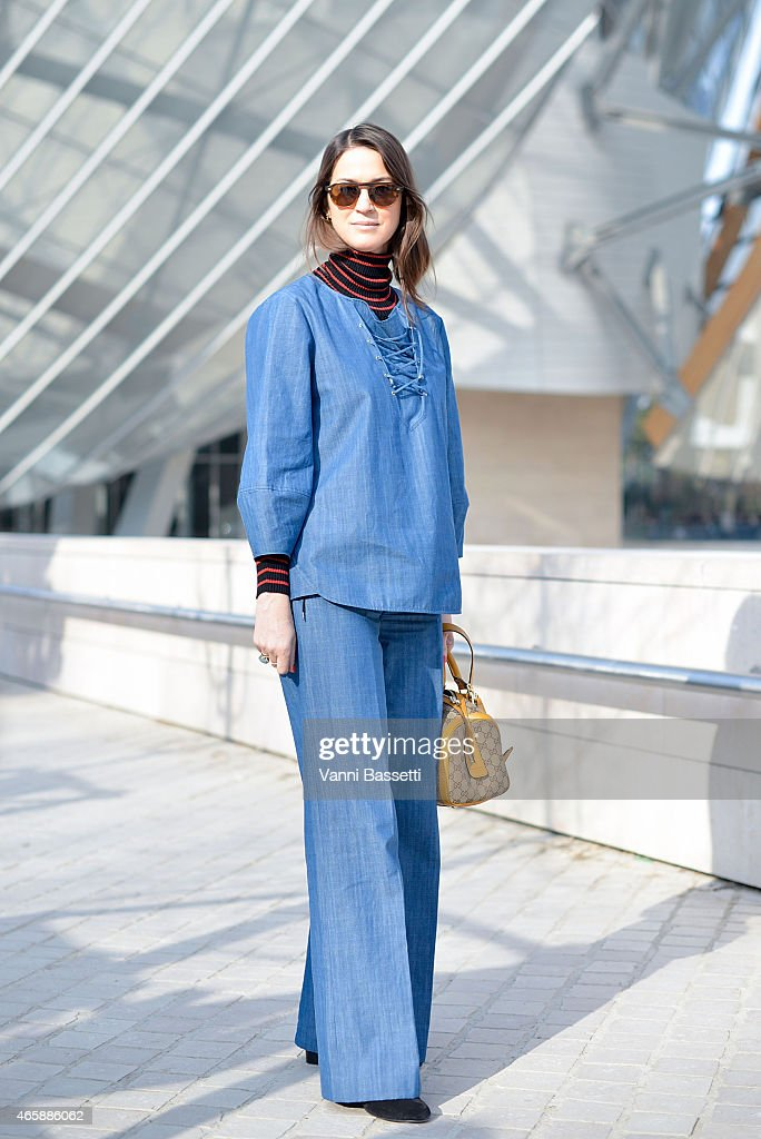 Emily Zack poses wearing a TIbi suit and a Gucci bag on Day 9 of Paris Fashion Week Womenswear FW15 on March 11 2015 in Paris France