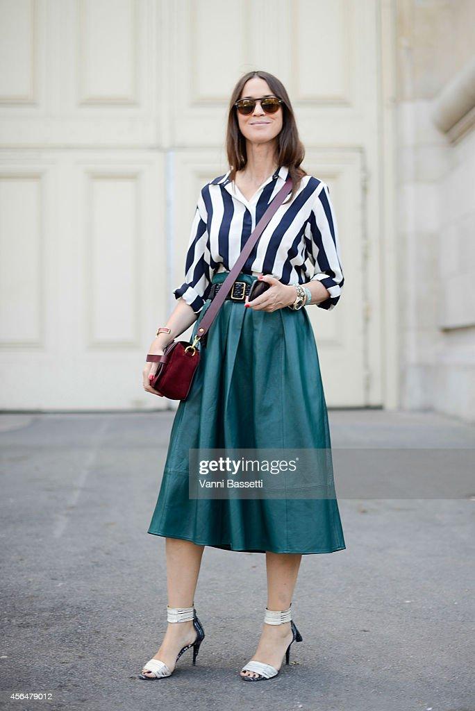 Emily Zak poses wearing a Stella McCartney shirt Tibi skirt and Jerome Dreyfuss bag on the streets of Paris during Paris Fashion Week on October 1...