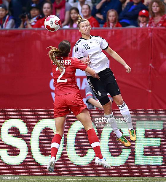 Emily Zurrer of Canada looks on as Alexandra Popp of Germany heads the ball during their Women's international friendly game at BC Place on June 18...