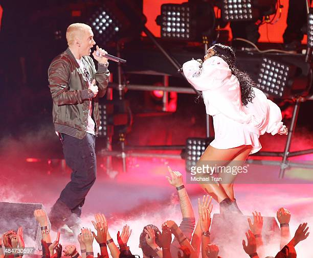 Eminem and Rihanna perform onstage during the 2014 MTV Movie Awards held at Nokia Theatre LA Live on April 13 2014 in Los Angeles California