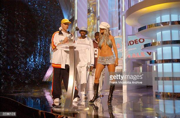 Eminem D12 and Christina Aguilera on stage at the 2002 MTV Video Music Awards at Radio City Music Hall in New York City August 29 2002 Photo by Frank...