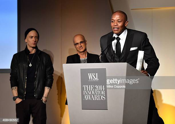 Eminem Jimmy Iovine and Dr Dre speak onstage at WSJ Magazine 2014 Innovator Awards at Museum of Modern Art on November 5 2014 in New York City