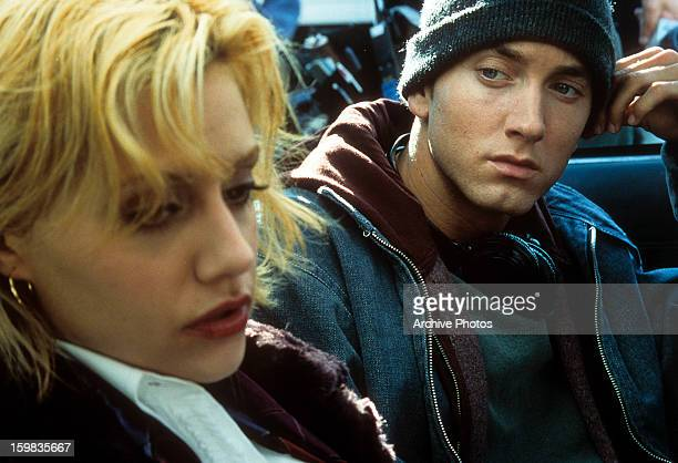 Eminem looking over at Brittany Murphy in a scene from the film '8 Mile' 2002