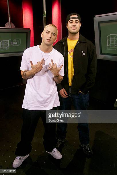 Eminem poses for a photo with Carson Daly on set of TRL at the MTV Studios in New York City on May 10 2000 Photo by Scott Gries/Getty Images