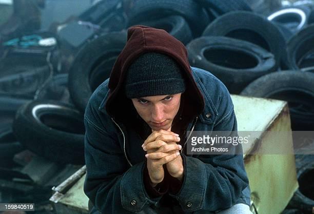 Eminem sitting in junkyard in a scene from the film '8 Mile' 2002