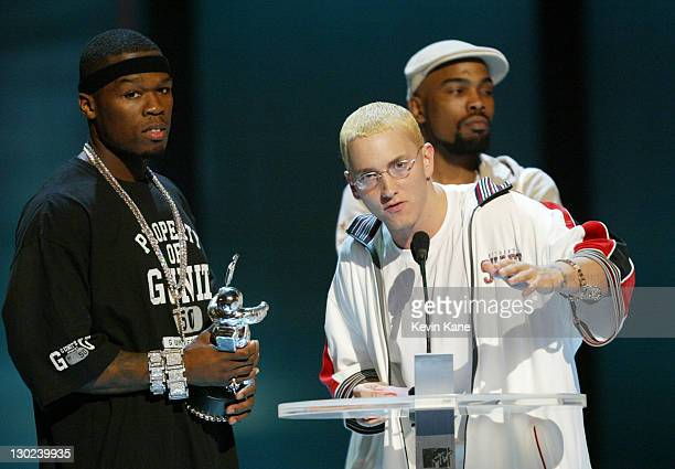 Eminem speaks after 50 Cent accepts the award for Best Rap Video at the 2003 MTV Video Music Awards