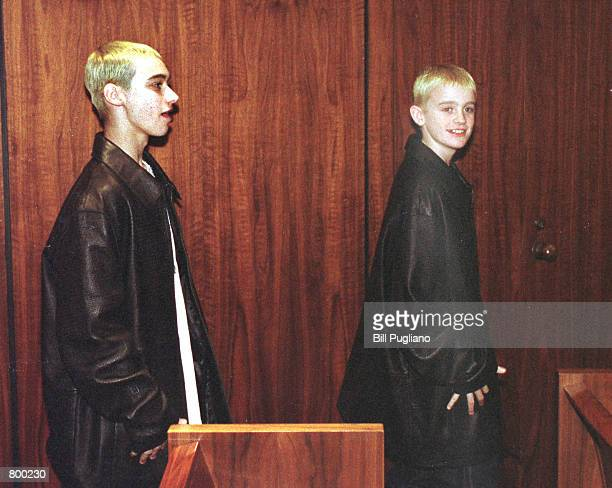 Eminem's half brother Nate left and his cousin Joshua Schmitt exit a Macomb County courtroom following Eminem's sentencing on concealed weapons...