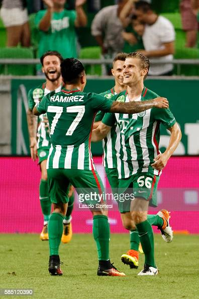 Emir Dilaver of Ferencvarosi TC celebrates scoring his team's goal with Cristian Ramirez of Ferencvarosi TC before Marco Djuricin and Dominik Nagy of...