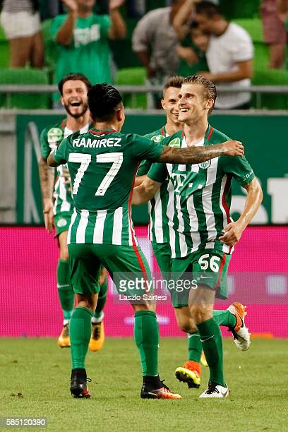 Emir Dilaver of Ferencvarosi TC celebrates scoring his team's goal with Cristian Ramirez of Ferencvarosi TC before Marco Djuricin and Dominik Nagy of...