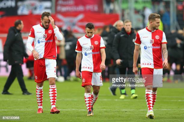 Emir Kujovic Davor Lovren and Andre Hoffmann of Duesseldorf look dejected after the Second Bundesliga match between FC Ingolstadt 04 and Fortuna...