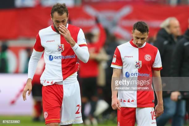 Emir Kujovic of Duesseldorf and his team mate Davor Lovren look dejected after the Second Bundesliga match between FC Ingolstadt 04 and Fortuna...