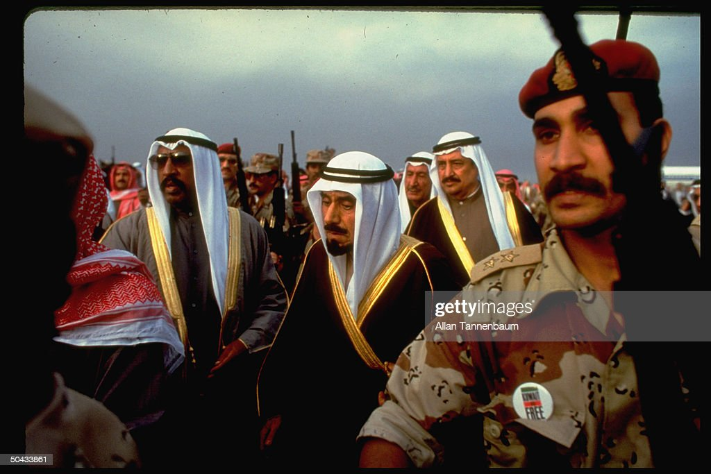 Emir of Kuwait Sheik Jaber Ahmed alSabah surrounded by soldiers as he returns to his homeland after the end of the Gulf War