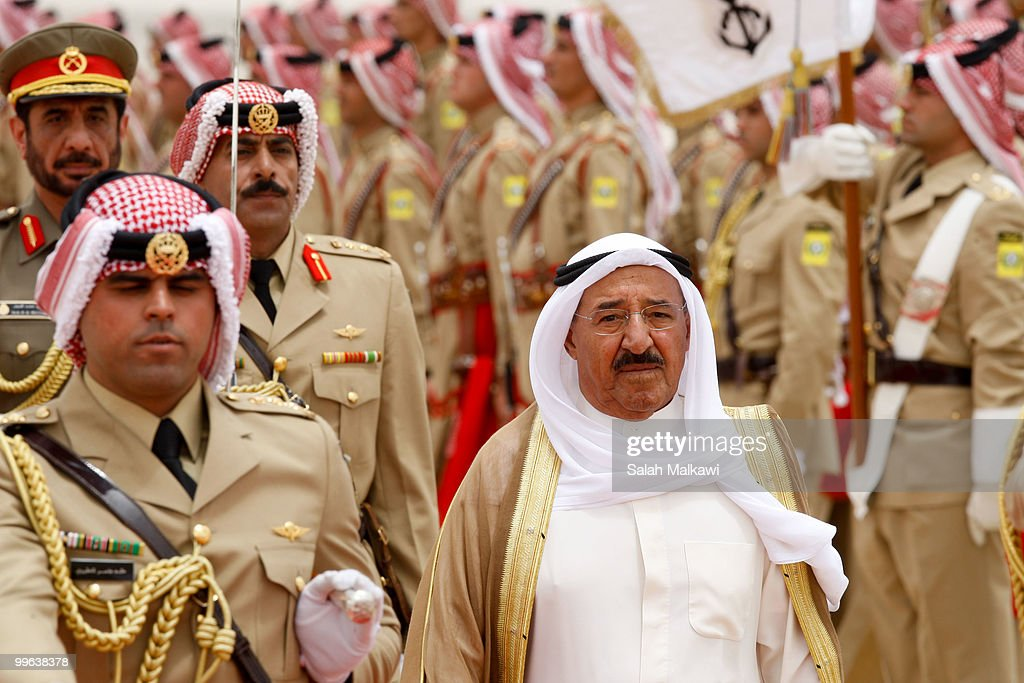 Emir of Kuwait Sheikh <a gi-track='captionPersonalityLinkClicked' href=/galleries/search?phrase=Sabah+Al-Ahmad+Al-Jaber+Al-Sabah&family=editorial&specificpeople=5573991 ng-click='$event.stopPropagation()'>Sabah Al-Ahmad Al-Jaber Al-Sabah</a> is welcomed by a military parade as he arrives at Amman airport on May 17, 2010 in Amman, Jordan. The ruler of Kuwait is on a two-day state visit, the first such visit by a Kuwaiti head of state in 20 years, and is expected to discuss the US-brokered indirect peace talks between Israel and the Palestinians.