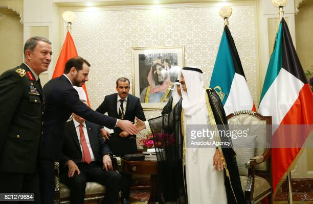 Emir of Kuwait Sheikh Sabah AlAhmad AlJaber AlSabah shakes hands with Turkish Minister of Energy and Natural Resources Berat Albayrak as Chief of the...