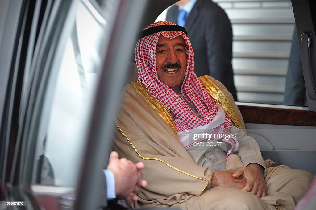Emir of Kuwait Sheikh Sabah al-Ahmad al-Sabah sits in a car as he arrives at Heathrow Airport in west London on November 26, 2012, for a state visit. The ruler of Kuwait arrived to pay a state visit to Britain in November when he will stay in the regal splendour of Windsor Castle as a guest of Queen Elizabeth II, Buckingham Palace. AFP PHOTO / CARL COURT