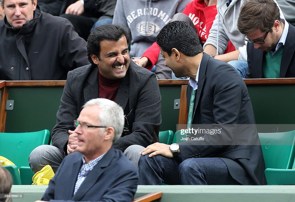 Emir of Qatar, Sheikh Tamim Ben Hamad Al-Thanih and president of Paris Saint-Germain <a gi-track='captionPersonalityLinkClicked' href=/galleries/search?phrase=Nasser+Al-Khelaifi&family=editorial&specificpeople=7941556 ng-click='$event.stopPropagation()'>Nasser Al-Khelaifi</a> attend Day 3 of the French Open 2014 held at Roland-Garros stadium on May 27, 2014 in Paris, France.