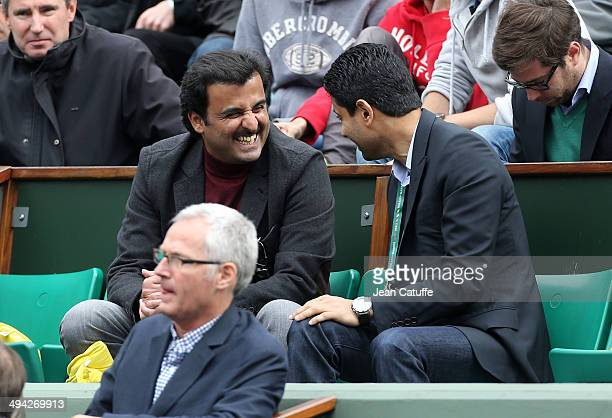Emir of Qatar Sheikh Tamim Ben Hamad AlThanih and president of Paris SaintGermain Nasser AlKhelaifi attend Day 3 of the French Open 2014 held at...
