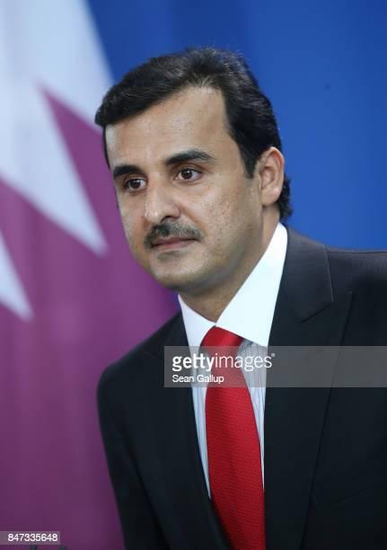 Emir of Qatar Sheikh Tamim bin Hamad Al Thani and German Chancellor Angela Merkel speak to the media following talks at the Chancellery on September...