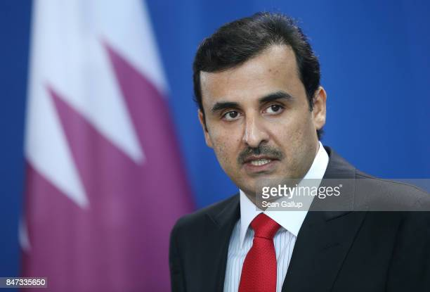 Emir of Qatar Sheikh Tamim bin Hamad Al Thani and German Chancellor Angela Merkel speak to the media following talks at the Chancellery on September...