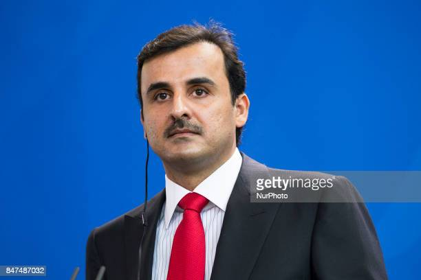 Emir of Qatar Sheikh Tamim bin Hamad Al Thani is pictured during a news conference held with German Chancellor Angela Merkel at the Chancellery in...