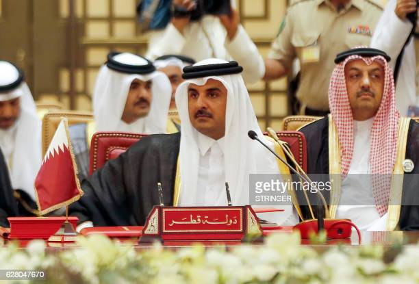 Emir of Qatar Sheikh Tamim bin Hamad alThani attends a Gulf Cooperation Council summit on December 6 in the Bahraini capital Manama / AFP PHOTO /...