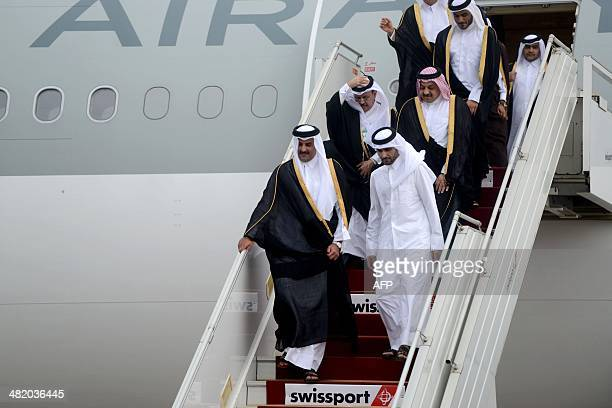 Emir of Qatar Sheikh Tamim bin Hamad AlThani exits the plane upon his arrival at Algiers's International Airport on April 2 2014 AFP PHOTO/ FAROUK...