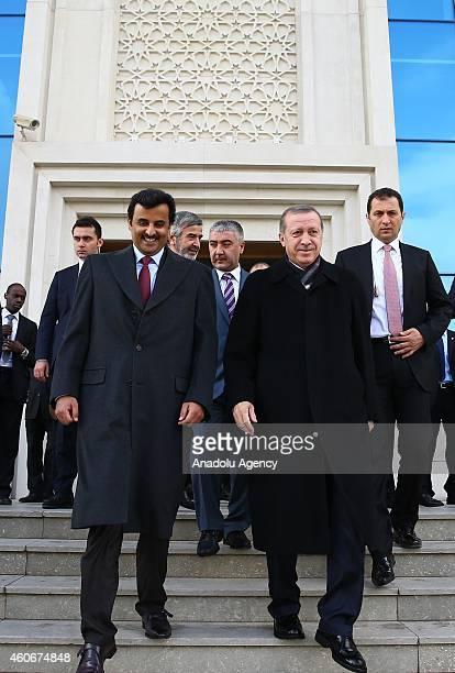 Emir of Qatar Sheikh Tamim bin Hamad bin Khalifa Al Thani and Turkish President Recep Tayyip Erdogan walks together as they leave the Ahmet Hamdi...