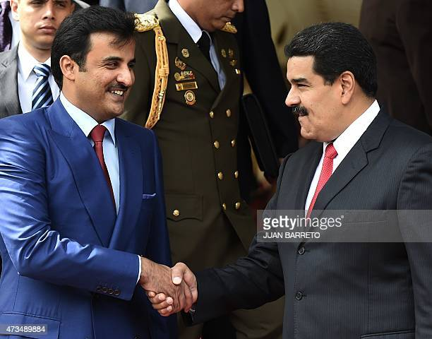 Emir of Qatar Sheikh Tamim bin Hamad bin Khalifa Al Thani is welcomed by Venezuelan president Nicolas Maduro to Miraflores presidential palace in...