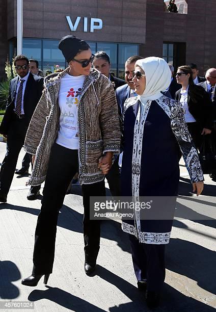 Emir of Qatar Sheikh Tamim's mother Sheikha Mozah and Turkey's First Lady Emine Erdogan walk handtohand during their visit to the Syrian Refugee Camp...