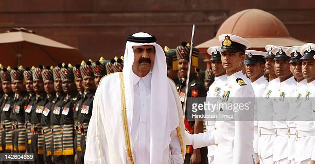 Emir of the State of Qatar Sheikh Hamad Bin Khalifa AlThani inspects the guard of honour during his Ceremonial Reception at Rashtrapati Bhawan on...