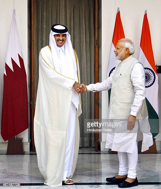 Emir of the State of Qatar Sheikh Tamim bin Hamad AlThani and Prime Minister Narendra Modi pose for a photograph prior to a meeting on March 25 2015...