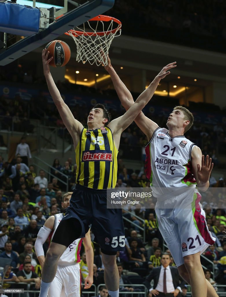 Emir Preldzic, #55 of Fenerbahce Ulker Istanbul competes with <a gi-track='captionPersonalityLinkClicked' href=/galleries/search?phrase=Tibor+Pleiss&family=editorial&specificpeople=4538830 ng-click='$event.stopPropagation()'>Tibor Pleiss</a>, #21 of Laboral Kutxa Vitoria in action during the 2013-2014 Turkish Airlines Euroleague Top 16 Date 6 game between Fenerbahce Ulker Istanbul v Laboral Kutxa Vitoria at Ulker Sports Arena on February 13, 2014 in Istanbul, Turkey.