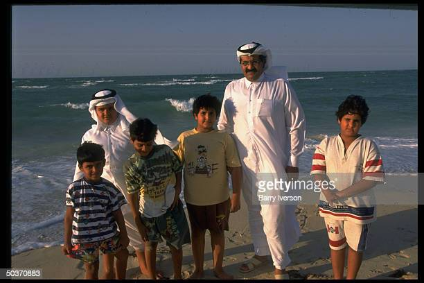 Emir Sheikh Hamad bin Khalifa alThani enjoying leisure time on beach w 5 of his sons
