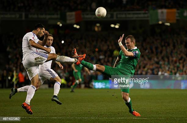 Emir Spahic of Bosnia and Herzegovina and Glenn Whelan of the Republic of Ireland compete for the ball during the UEFA EURO 2016 Qualifier play off...
