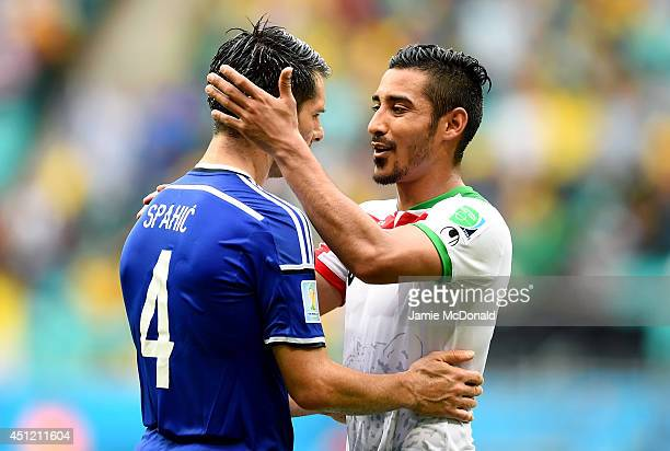 Emir Spahic of Bosnia and Herzegovina and Reza Ghoochannejhad of Iran greet each other after the 2014 FIFA World Cup Brazil Group F match between...