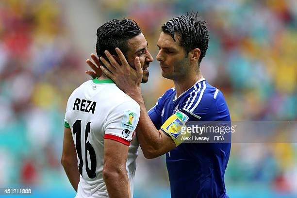 Emir Spahic of Bosnia and Herzegovina and Reza Ghoochannejhad of Iran react during the 2014 FIFA World Cup Brazil Group F match between...