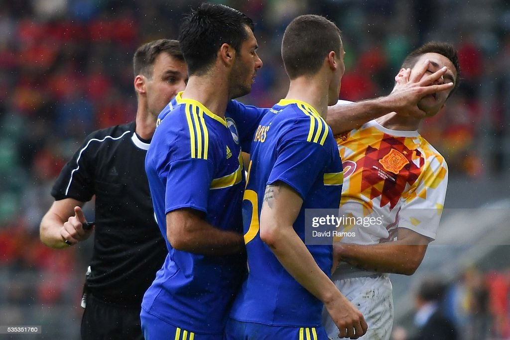 Emir Spahic of Bosnia slaps Cesar Azpilicueta of Spain during an international friendly match between Spain and Bosnia at the AFG Arena on May 29, 2016 in St Gallen, Switzerland.