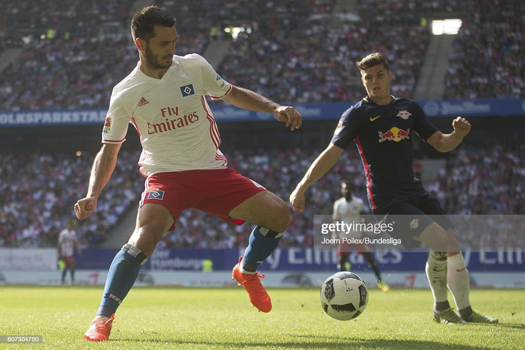 Emir Spahic of Hamburg and Marcel Sabitzer of Leipzig compete for the ball during the Bundesliga match between Hamburger SV and RB Leipzig at Volksparkstadion on September 17, 2016 in Hamburg, Germany.