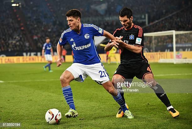 Emir Spahic of Hamburg is challenged by Alessandro Schöpf of Schalke during the Bundesliga match between FC Schalke 04 and Hamburger SV at...